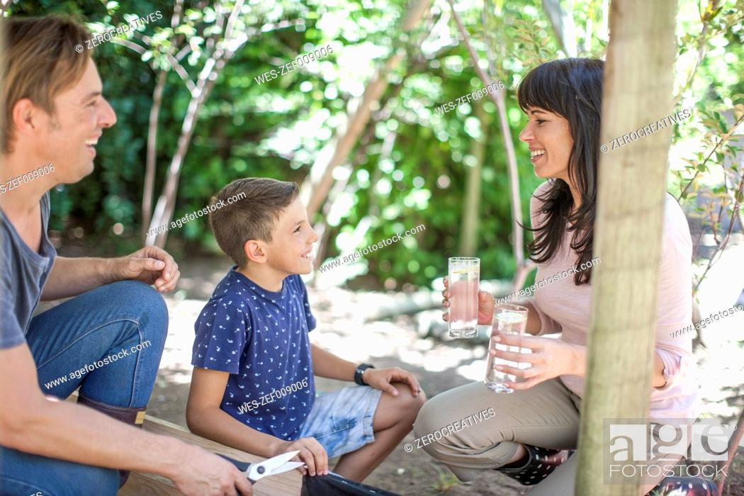 Stock Photo: Family in garden with glasses of water.