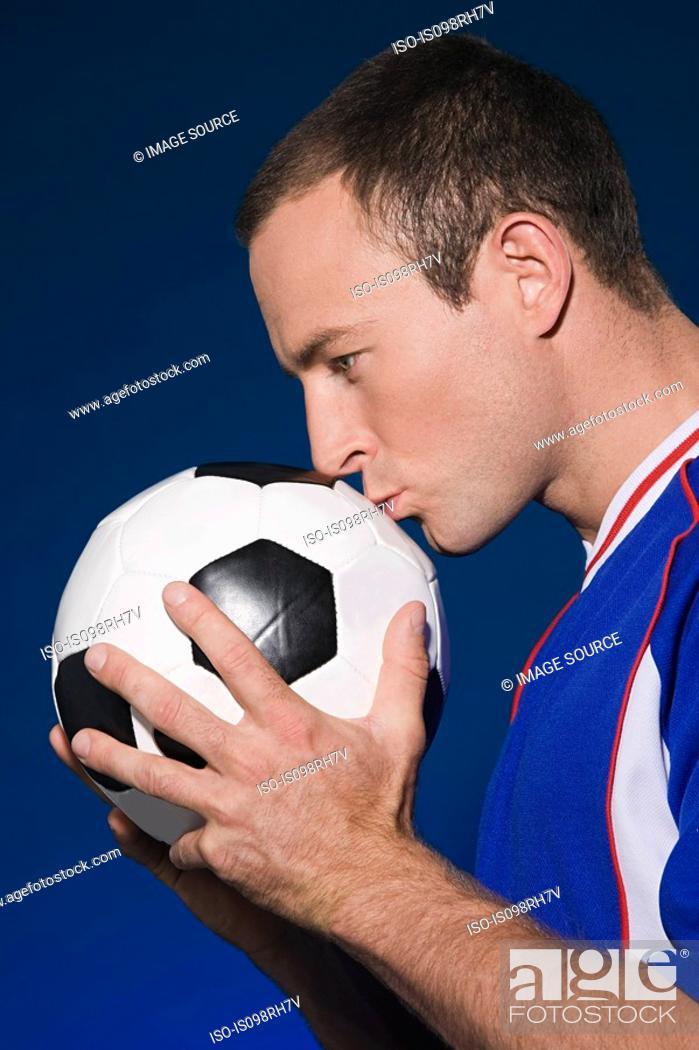 Stock Photo: Footballer kissing a football.