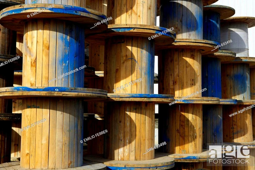 Stock Photo: Copper cable wooden rolls. Lleida, Catalonia, Spain.