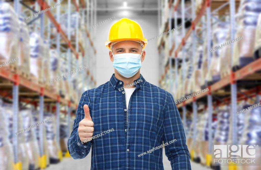 Stock Photo: male worker wearing face mask at warehouse.