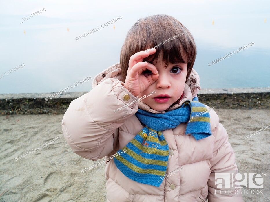 Stock Photo: Children playing on the beach in winter, Lake Maggiore, Ispra, Lombardy, Italy.