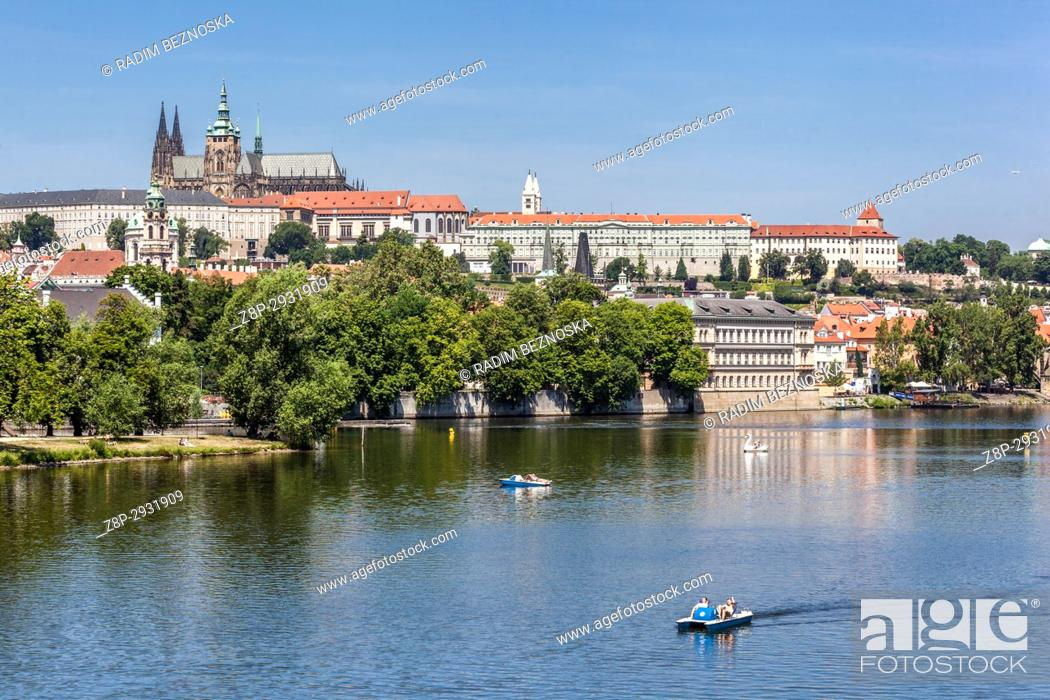 Stock Photo: Panorama of Prague with the Cathedral of St. Vitus at the Prague Castle over the Vltava River.