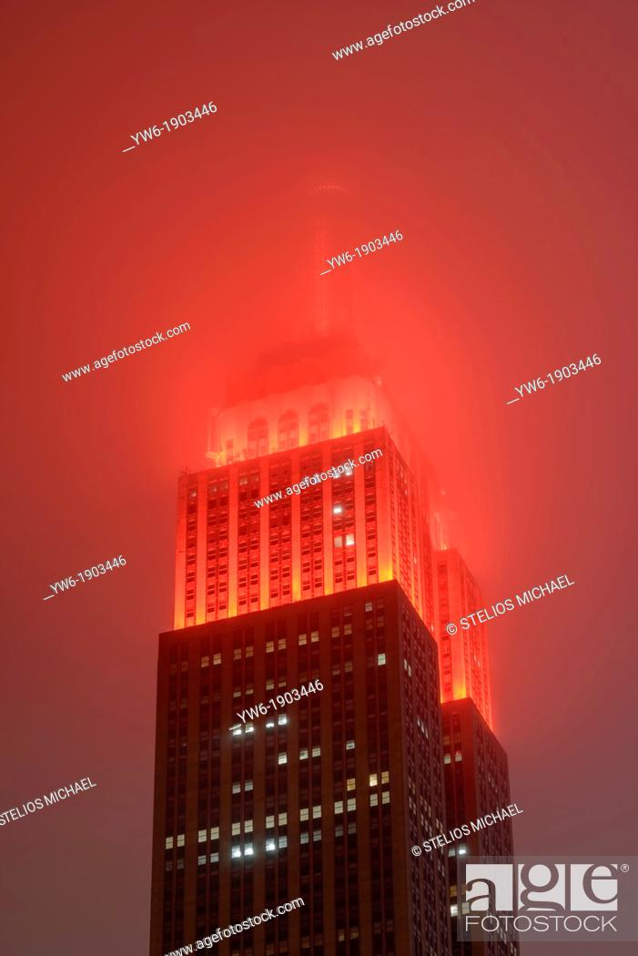 Stock Photo: Empire State Building in Fog, New York, USA.