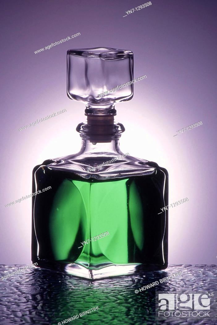 Stock Photo: generic bottle of glowing green liquid backlit.