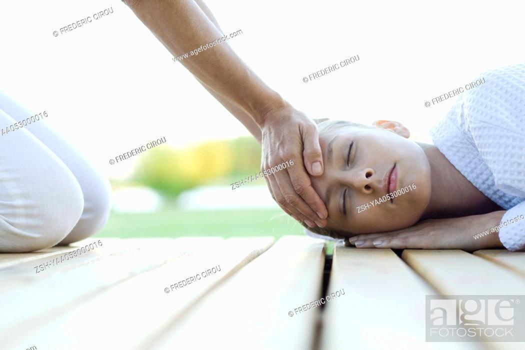 Stock Photo: Woman receiving head massage.