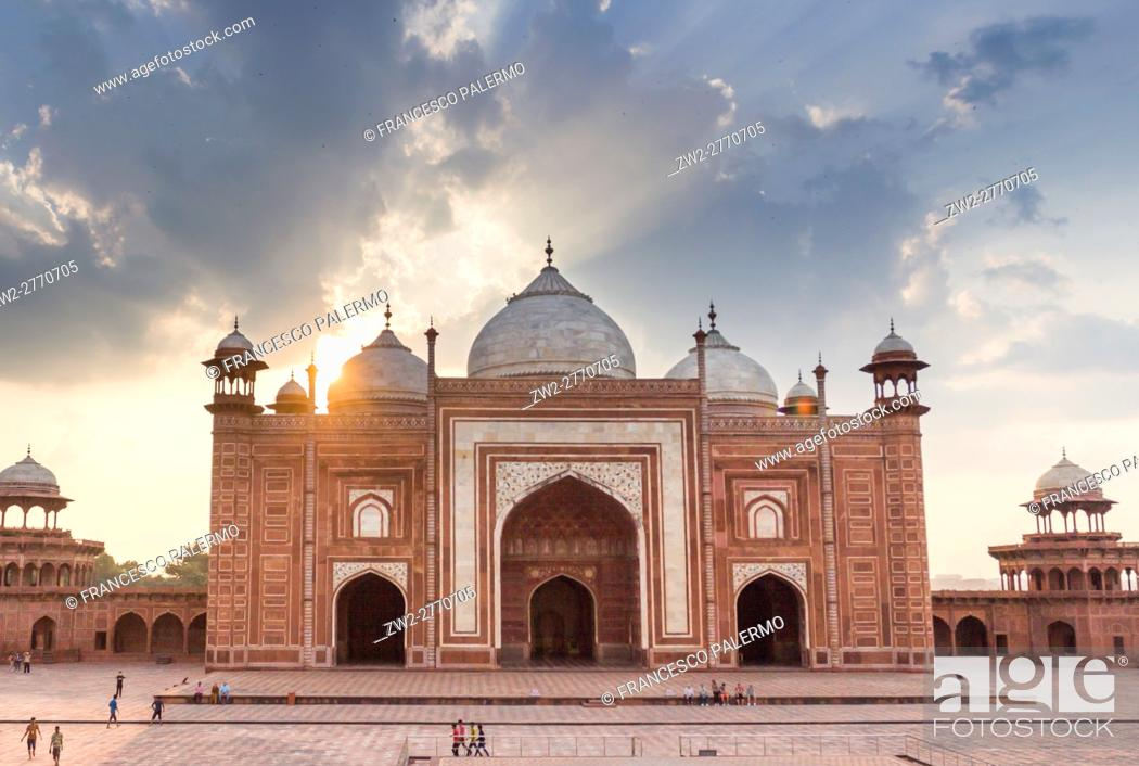 Stock Photo: The red facade of mosque located near of Taj Mahal in back lit of summer sunset. Agra, Uttar Pradesh. India.