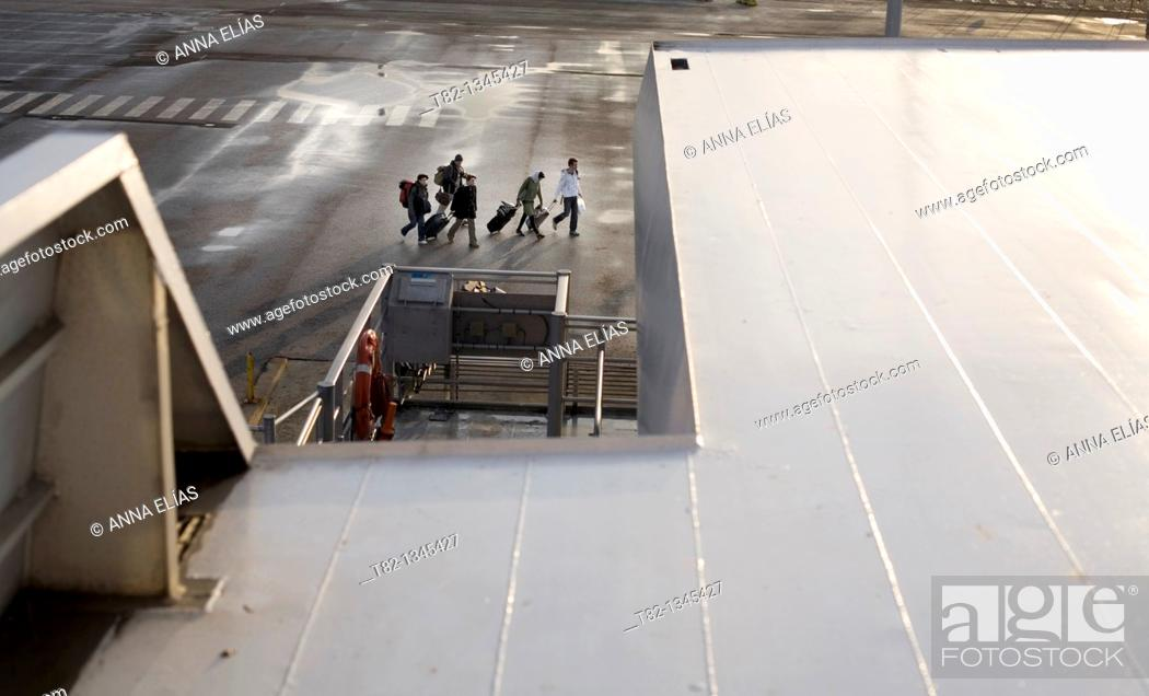 Stock Photo: group of passengers with luggage outside the Port of Algeciras, Cadiz, Andalucia, Spain.