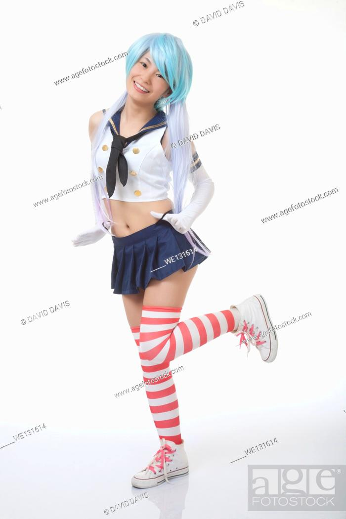 Stock Photo: Beautiful and sexy Chinese woman having some fun with cosplay isolated an a white background.