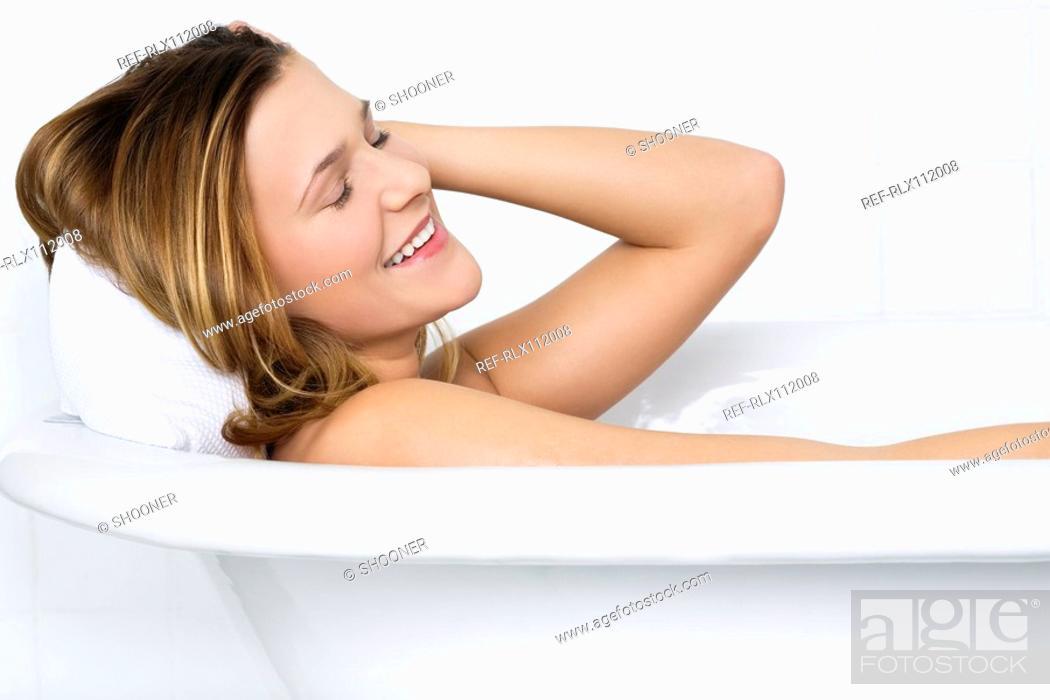 Stock Photo: woman having a bath.