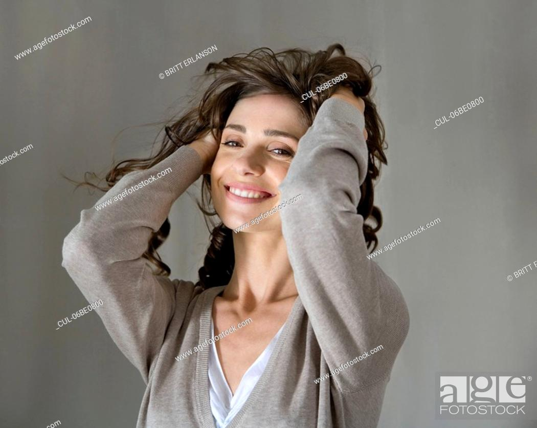 Stock Photo: Woman portrait with hands in hair.