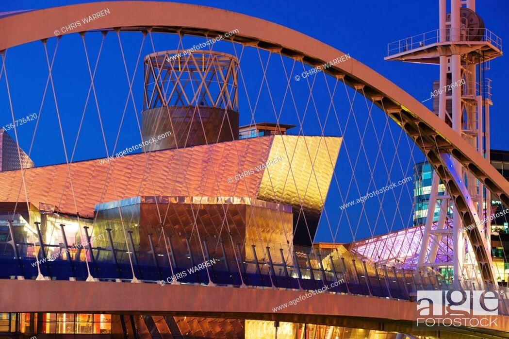 Stock Photo: Millennium Bridge & Lowry Centre Salford Quays Greater Manchester Lancashire England at twilight.