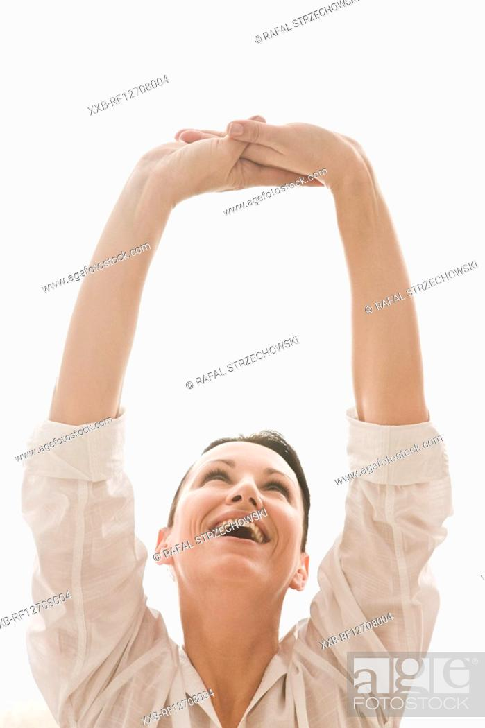 Stock Photo: woman with shoulders up.