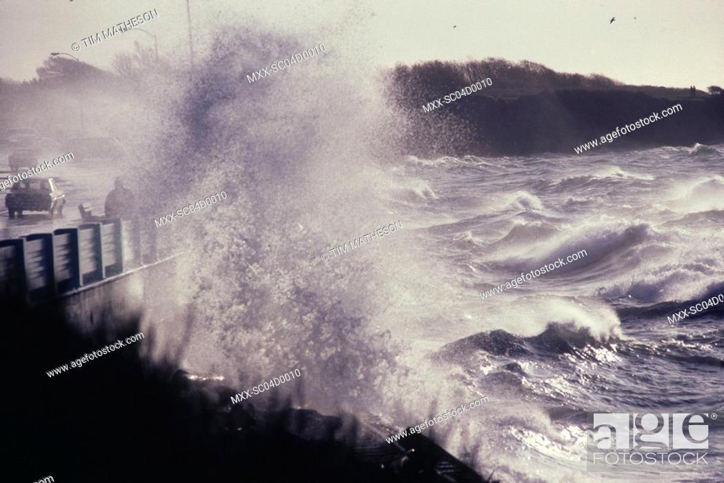 Stock Photo: waves crashing on bridge during storm.