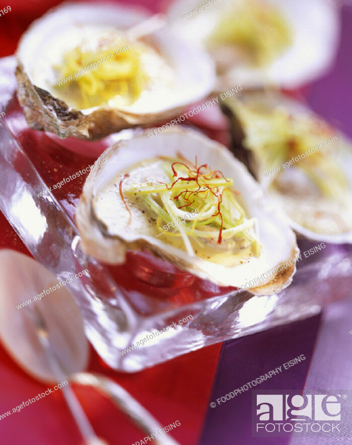 Stock Photo: Poached Oysters with Leeks and Saffron.