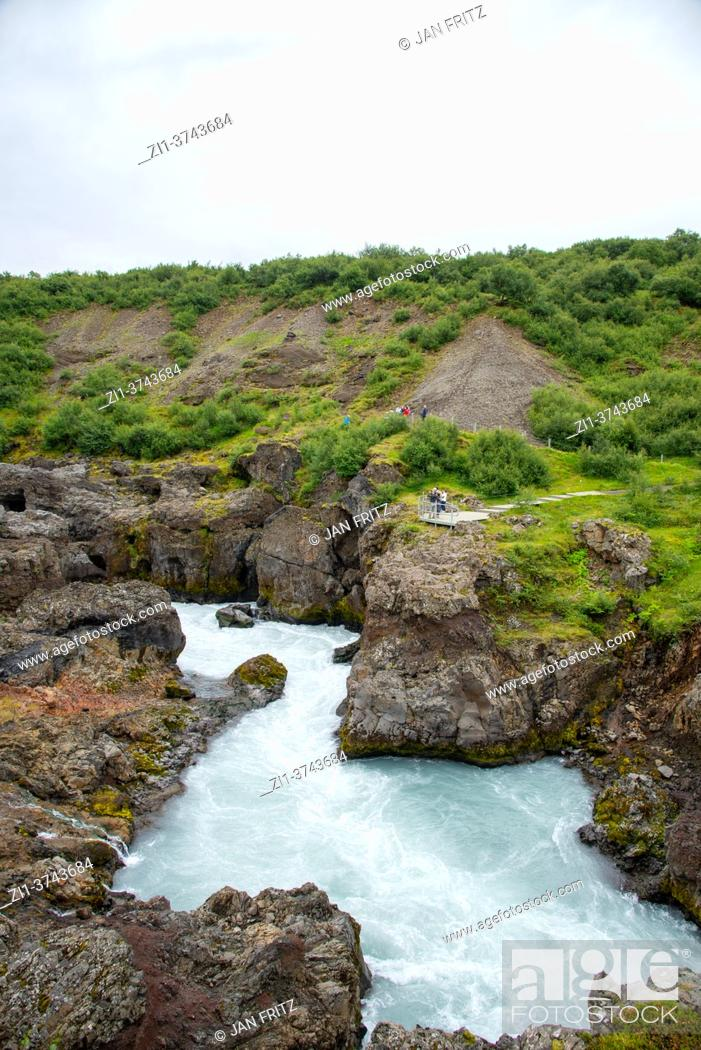 Stock Photo: view at Hraunfossar river in Iceland.