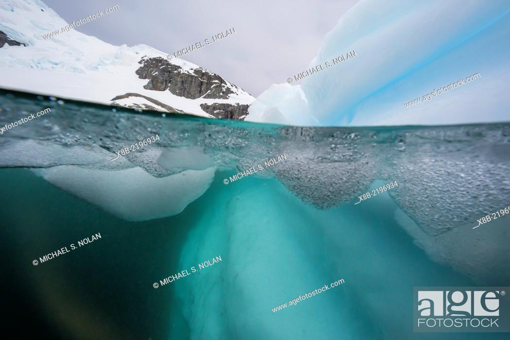 Stock Photo: Above and below view of glacial ice, Cuverville Island, Errera Channel, Antarctica.
