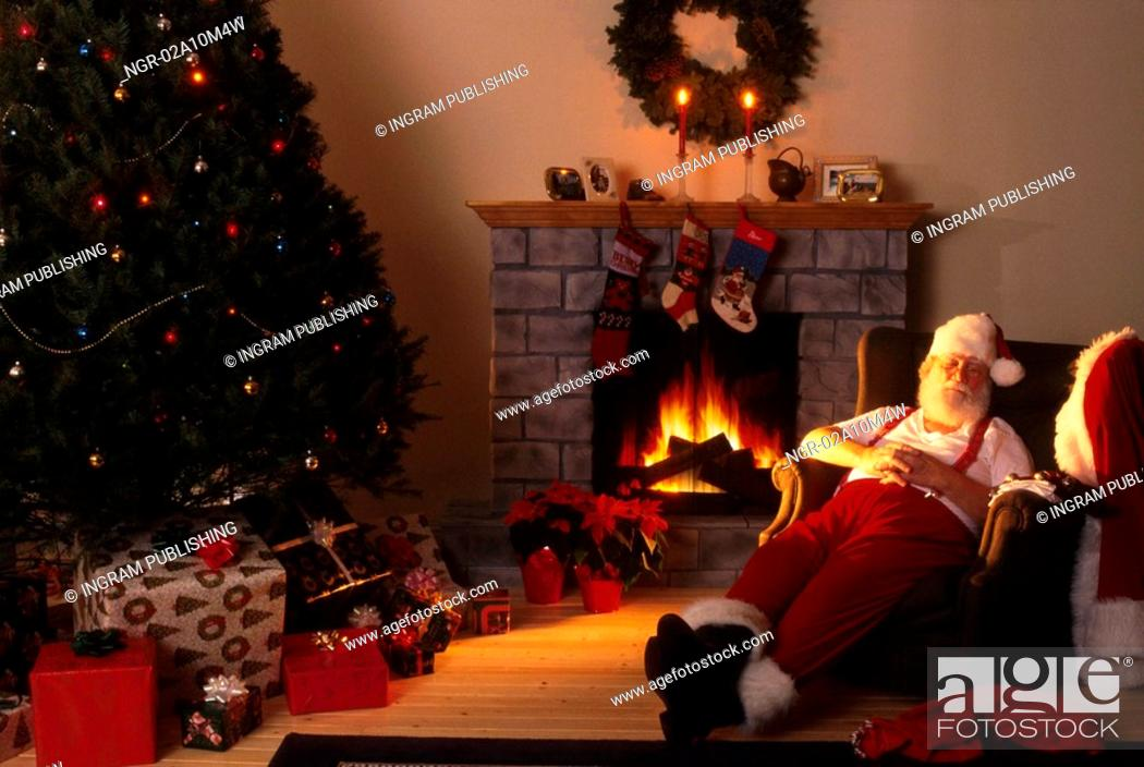 Stock Photo: Santa Asleep by the Fireplace.