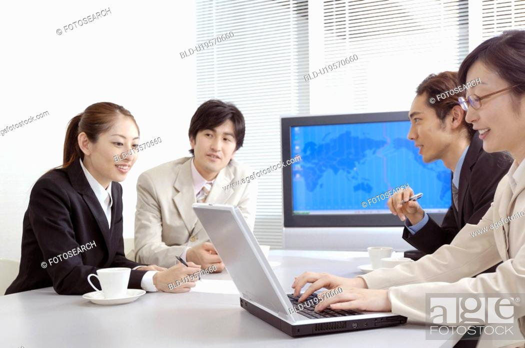 Stock Photo: Office workers during conference.