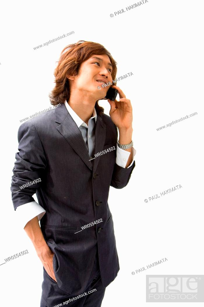Imagen: Young Asian business man with mobile phone calling, isolated.