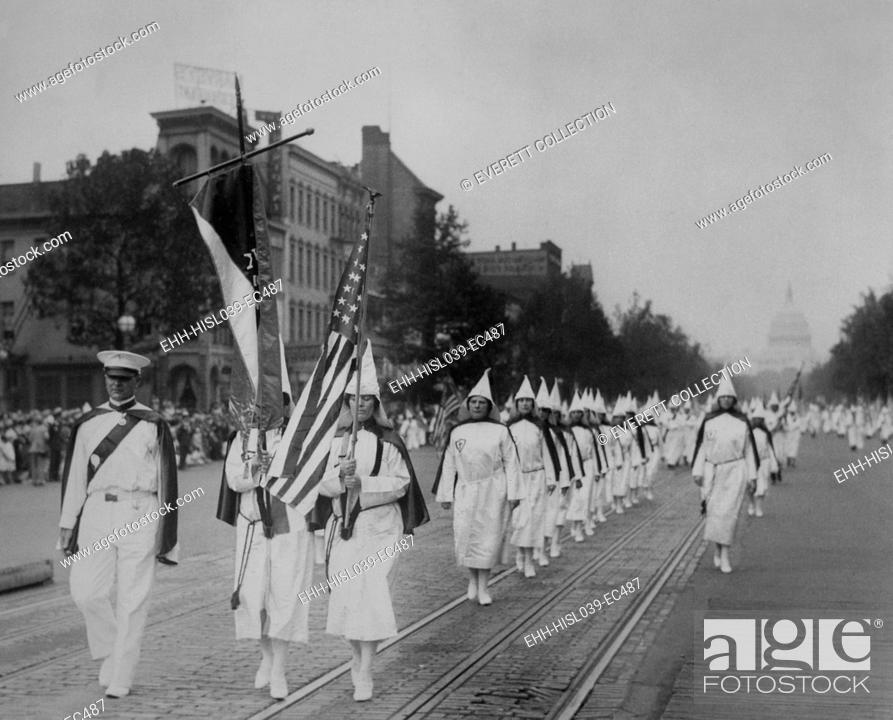 Stock Photo: Women members lead a 1928 Ku Klux Klan parade on Pennsylvania Avenue. After D. W. Griffith's film 'Birth of A Nation', portrayed Klansmen as heroes.