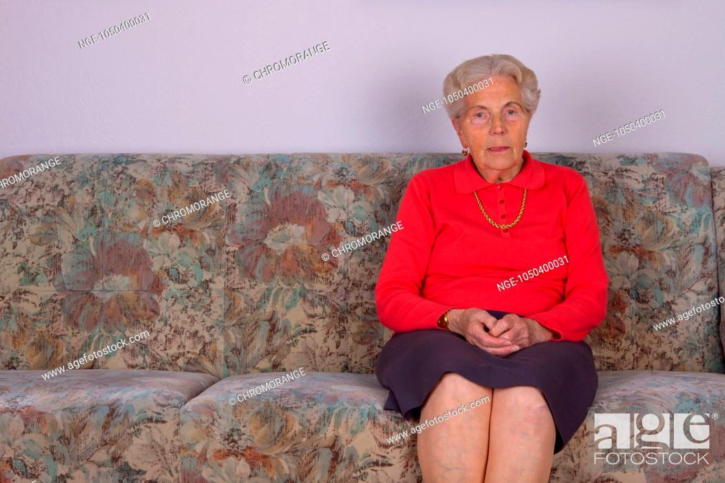 An Old Woman Sitting On Your Couch Stock Photo Picture And
