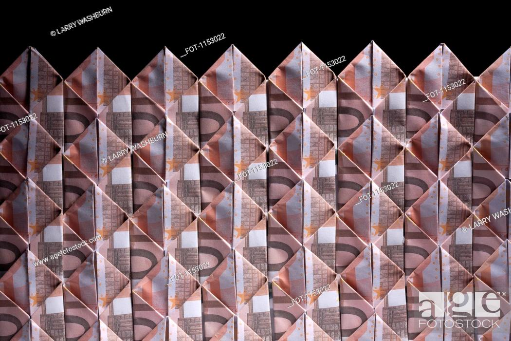 Stock Photo: Ten Euro banknotes folded into diamond shapes and interwoven.