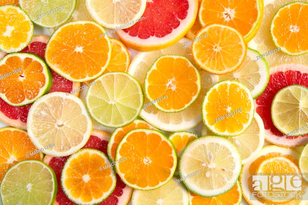 Stock Photo: Presenting a blend of citrus slices of different types.