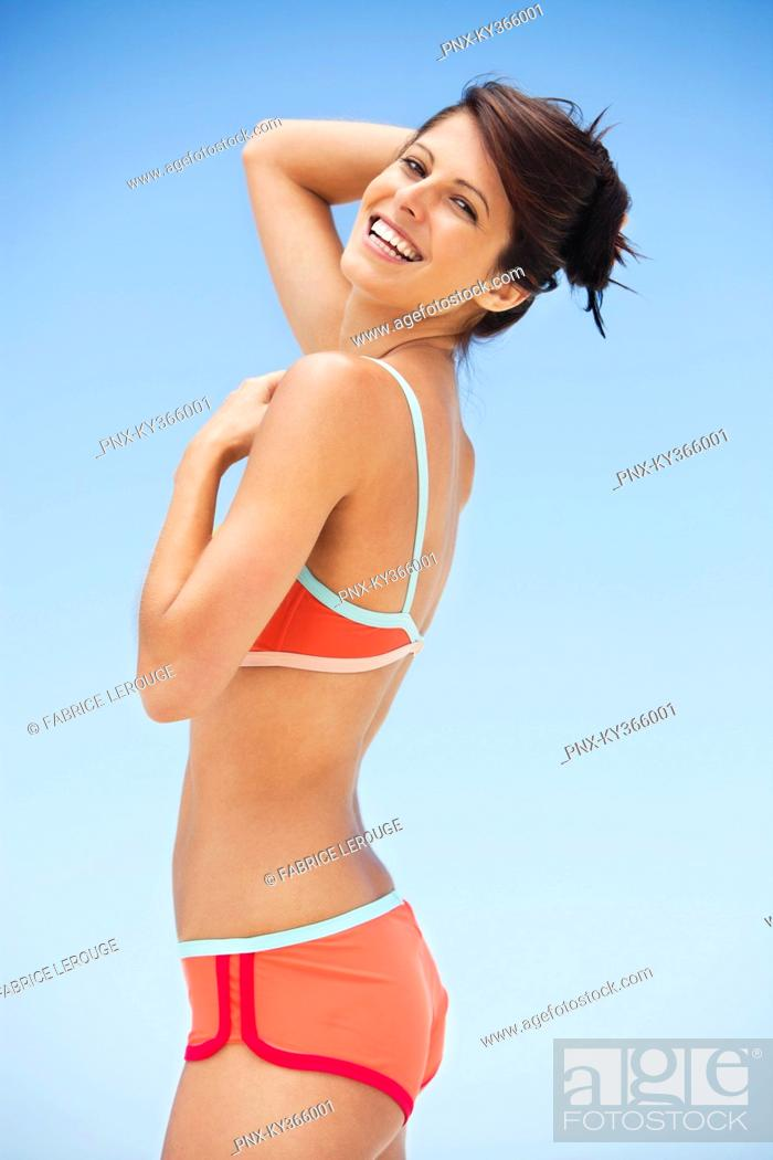 Stock Photo: Portrait of a woman posing on the beach.