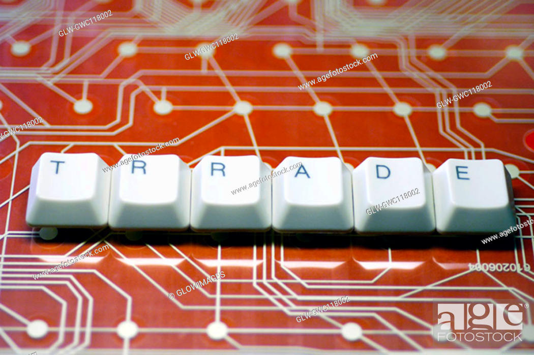 Stock Photo: High angle view of computer keys on a circuit board.