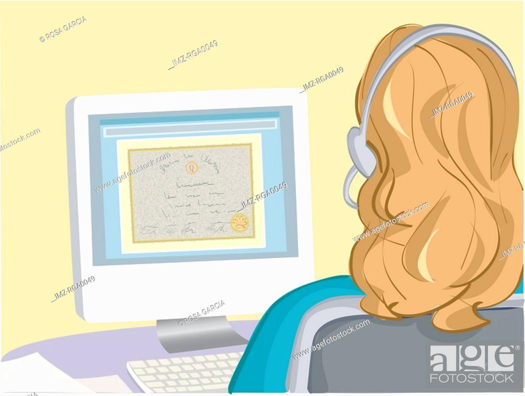Stock Photo: A businesswoman working late.