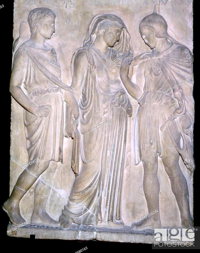 Stock Photo: A Roman replica of a classical Greek relief, showing from right to left Orpheus, Eurydice and Hermes. The names above the figures are incorrect and appear to.