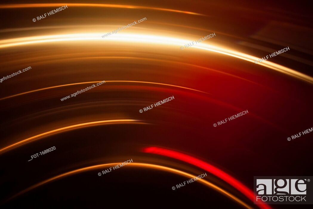Stock Photo: Abstract image of vibrant light trails against black background.