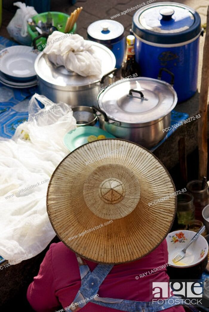 Stock Photo: Thailand, Bangkok, View from above of a street food stall with vendor wearing straw hat.