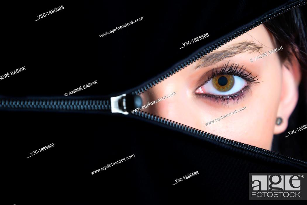 Stock Photo: Female face hidden behind opening zipper, 18 years, Caucasian.