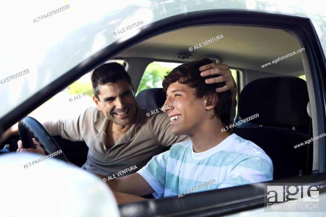 Stock Photo: Father teaching his son to drive.