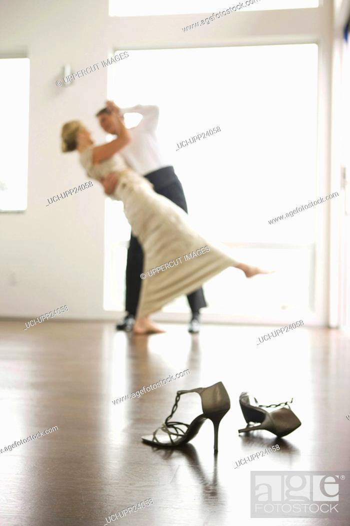 Stock Photo: Couple in eveningwear dancing.