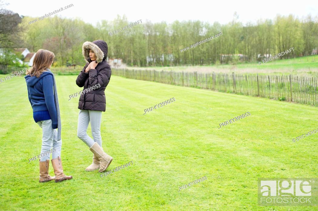 Stock Photo: Woman with her daughter standing in a field.