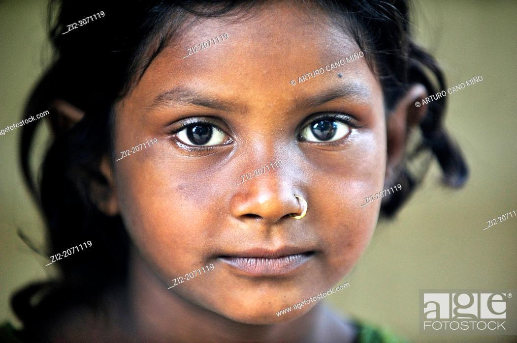 Stock Photo: Tharu young girl, Chitwan National Park, Nepal.