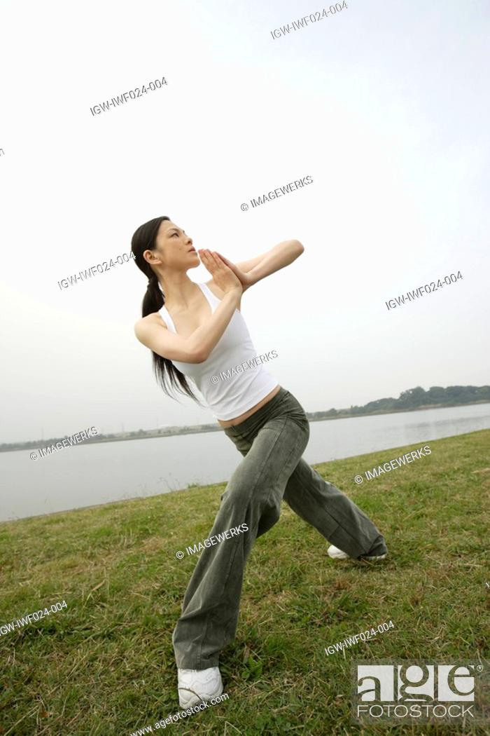 Stock Photo: View of a young woman exercising outdoors.