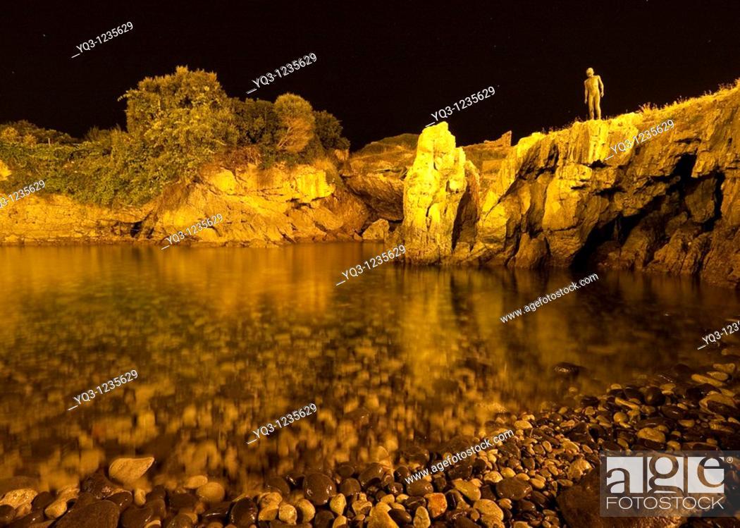 Stock Photo: Child statue over El Pedregal cove, Castro Urdiales, Cantabria, Northern Spain.