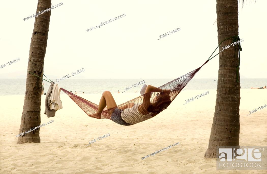 Stock Photo: people resting on a hammock  Cua Dai beach  Hoi An, Vietnam, Asia.