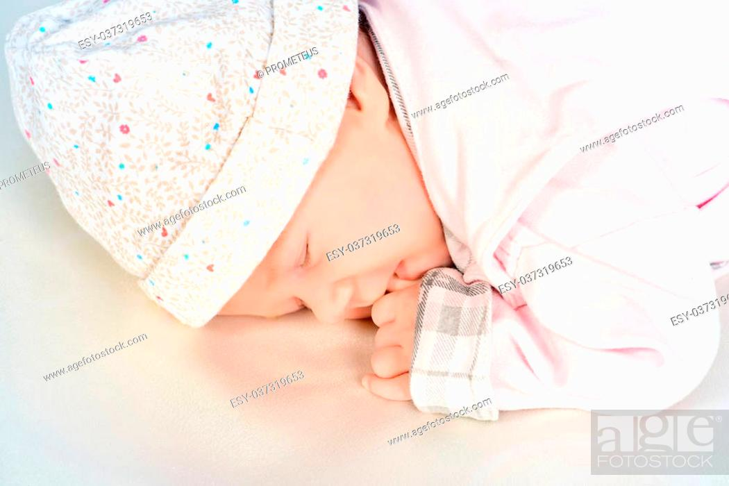 Stock Photo: Sweet little newborn baby sleeping in her bed.