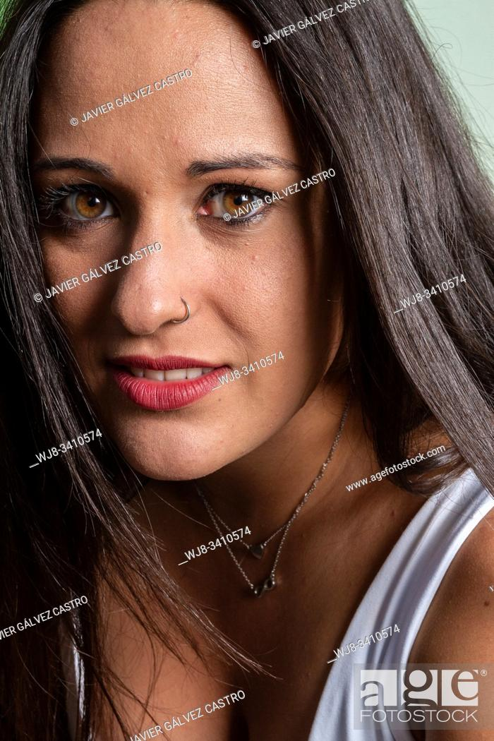 Stock Photo: studio lighting portrait of a young woman with expressive eyes.