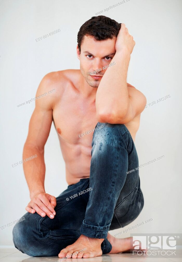Stock Photo: Portrait of sexy shirtless man sitting down on floor.