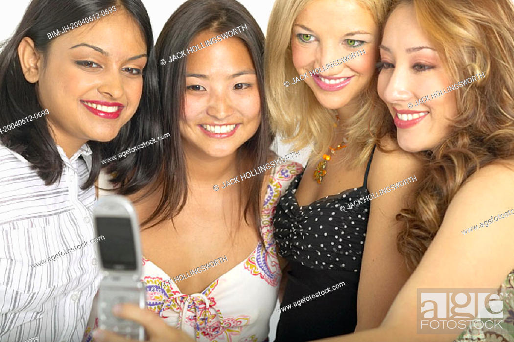 Stock Photo: Female friends taking photograph with cell phone.