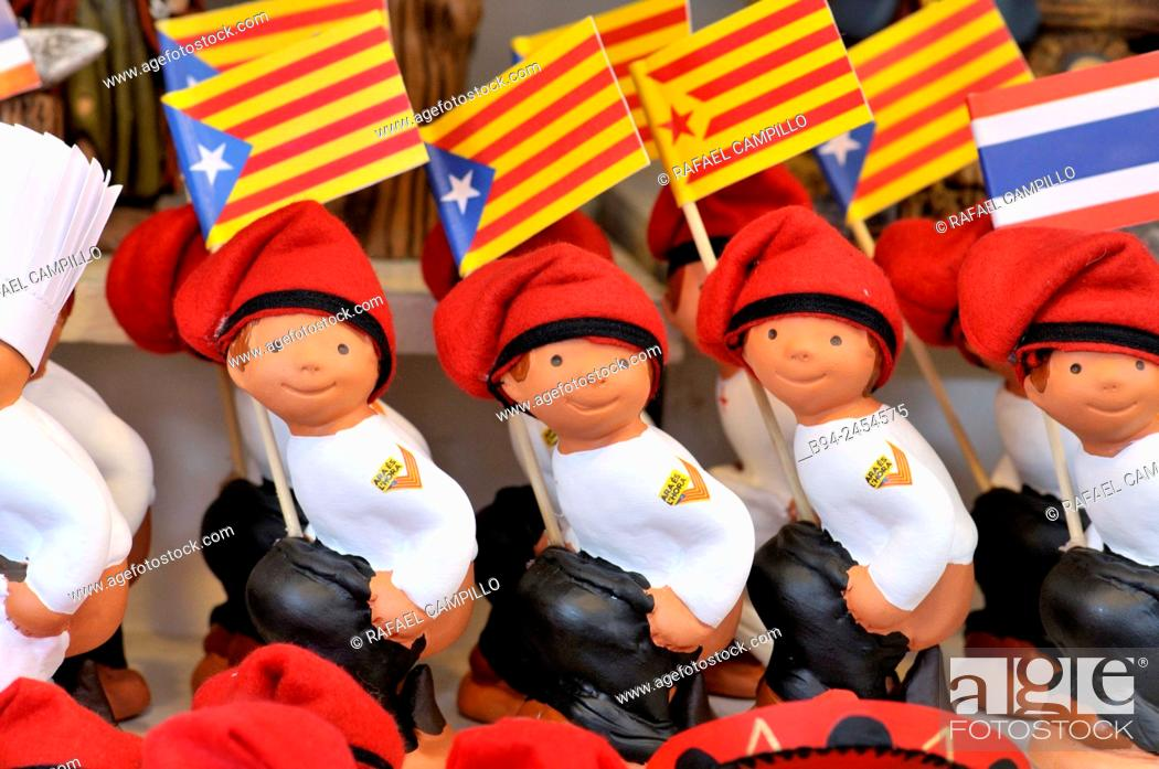 Stock Photo: 'Caganers', Catalonia independent flags, particular feature of modern nativity scenes at Santa Llucia Christmas fair, Barcelona. Catalonia, Spain.