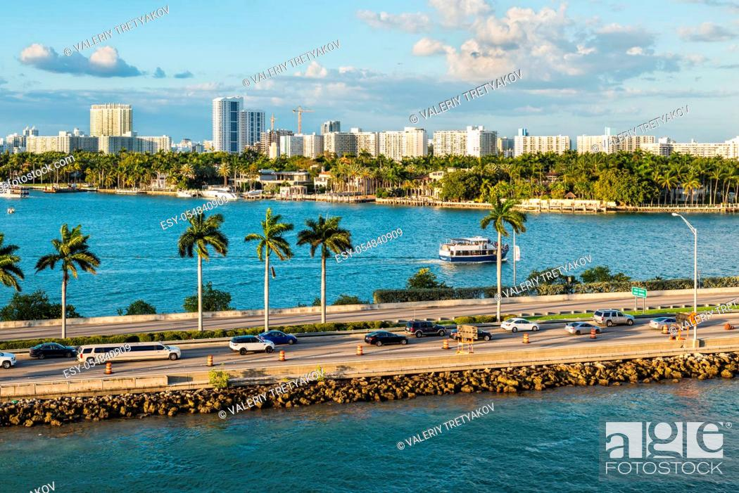 Stock Photo: Miami, FL, United States - April 20, 2019: MacArthur Causeway at Biscayne Bay in Miami, Florida, USA. The MacArthur Causeway is a colossal six-lane engineering.