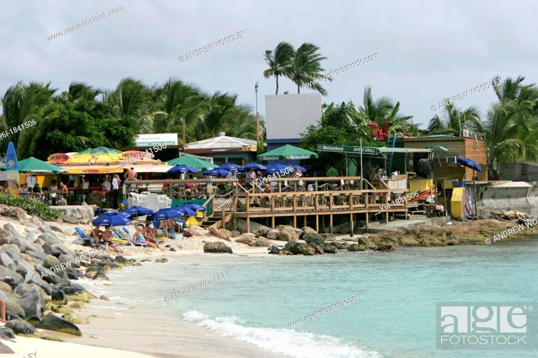 Stock Photo: Sunset Beach Bar Dutch Sint Maarten favourite spot for watching big jets landing at adjacent Princess Juliana airport.