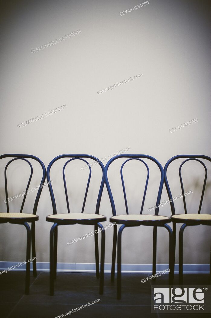 Stock Photo: Row of chairs against the wall.