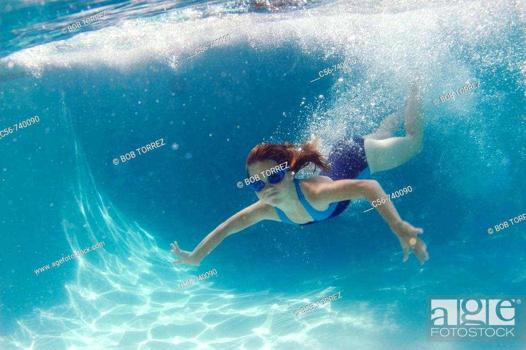 Stock Photo: Young girl underwater.